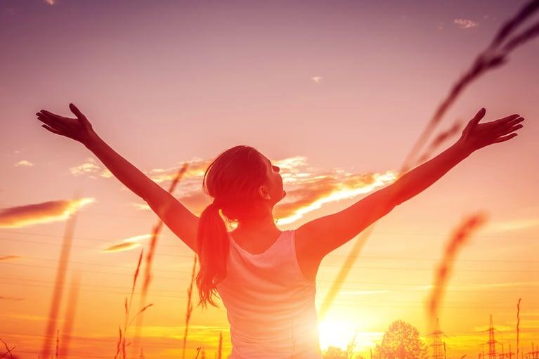 happy-woman-sunset