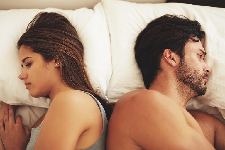 couple upset in bed