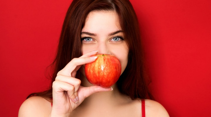 woman-holding-red-apple-picture-id1020200652