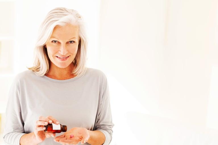 women taking probiotic supplements